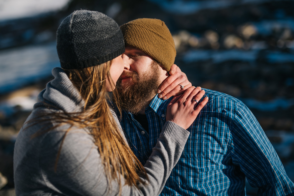 Beautiful cuddly pose during a winter engagement session in the Colorado Mountains - Photos by Maddie Mae Photography