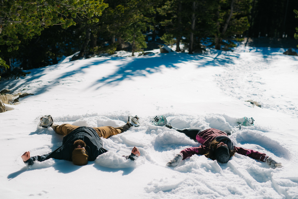 Snow Angel engagement photo by Maddie Mae Photography // Snowy winter engagement photographer