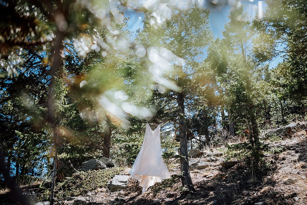 I love how this wedding dress was shot among the trees. I really want to have my wedding up in Estes Park somewhere.. Photo by Maddie Mae Photography