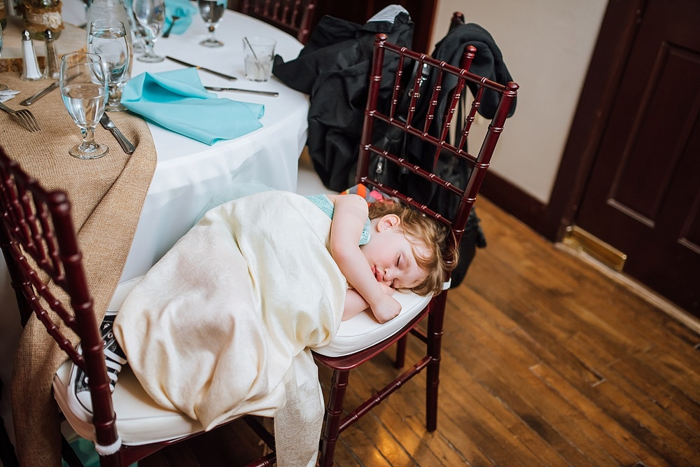 Little girl napping during the wedding ceremony at Mary's Lake Lodge up in Estes Park! This is adorable! Photo by Maddie Mae Photography