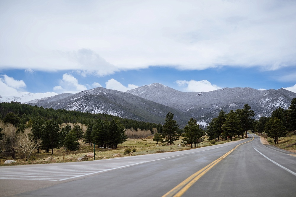 The road up to Rocky Mountain National Park is beautiful! The snow on the mountains is the perfect backdrop for a spring wedding. Photo by Maddie Mae Photography