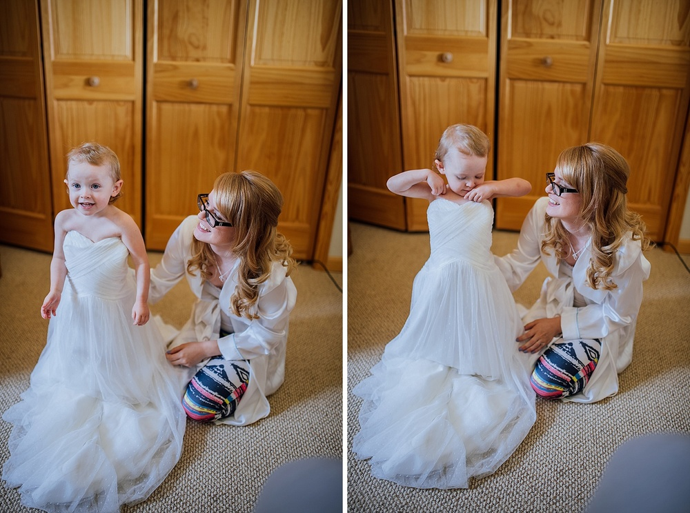 This little girl looks so happy and cute with her mom's wedding dress on! Photo by Maddie Mae Photography