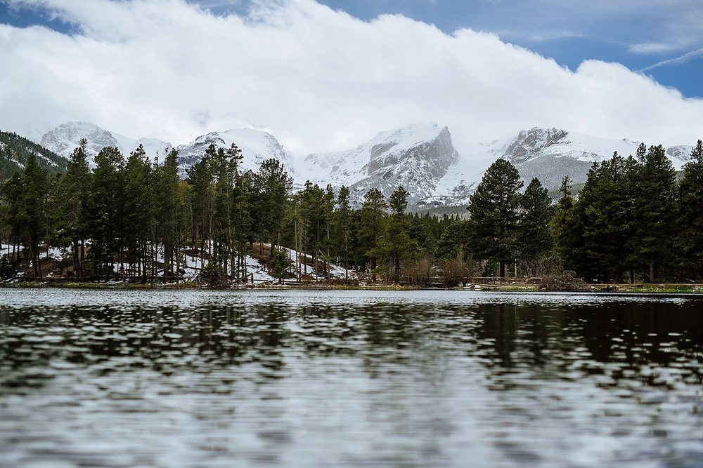 Sprague Lake in Rocky Mountain National Park, is one the most beautiful places in Colorado. The snowy mountains behind the tall evergreen trees and the crystal lake - amazing! Photo by Maddie Mae Photography