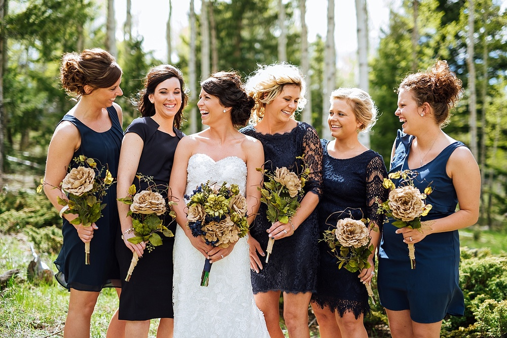 The aspen trees in the background of these bridesmaid photos are beautiful! I also love the royal blue color of the bridesmaid dresses against the white. Photo by Maddie Mae Photography