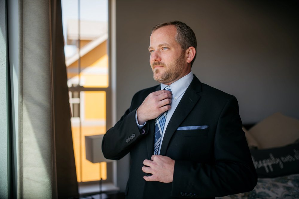 A great groom getting ready photo for a mountain wedding in Colorado! Photo by Maddie Mae Photography
