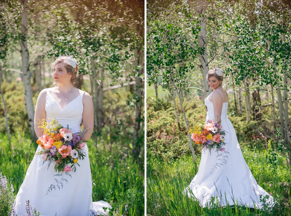 Bridal photos in the middle of a meadow with aspen trees and tall grass surrounding. Her wildflower bouquet works perfectly for this mountain wedding! Photo by Maddie Mae Photography
