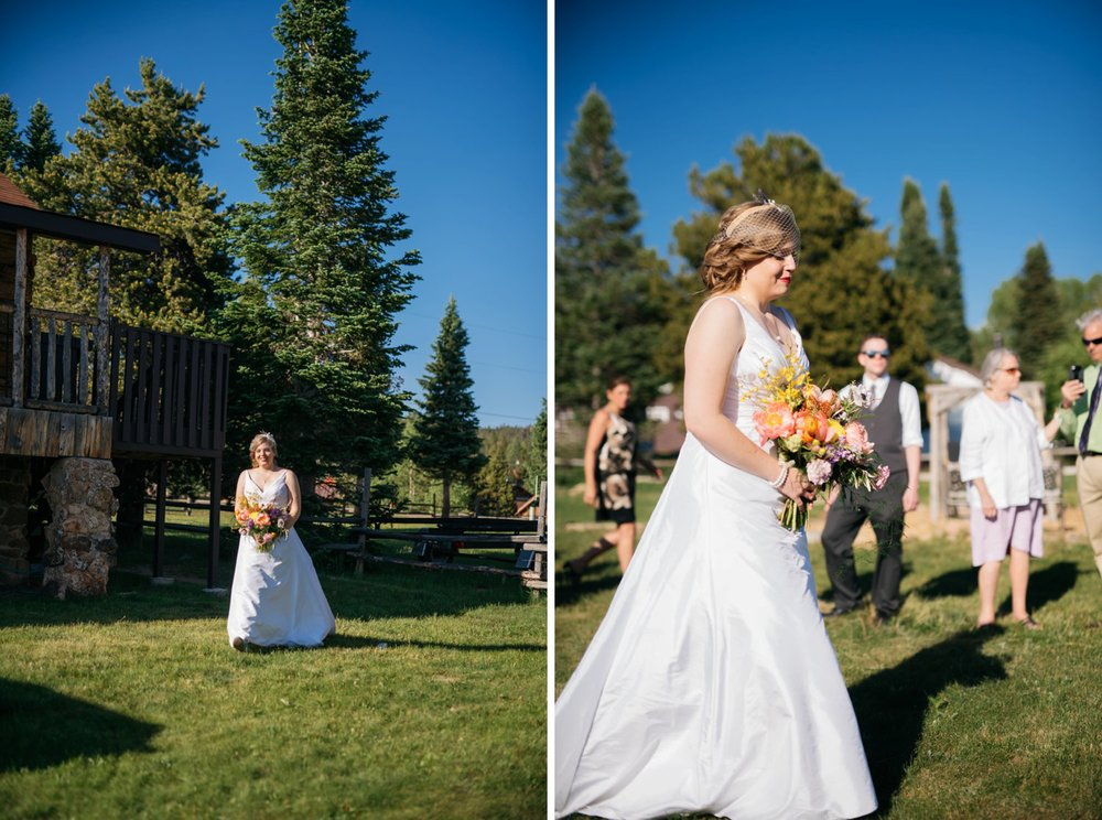 I love the bride's dress with her wildflower bouquet. It makes walking down the aisle look so beautiful. Photo by Maddie Mae Photography