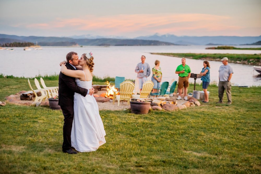 I love this first dance where the sun is just starting to set behind the lake. Intimate weddings are perfect! Photo by Maddie Mae Photography