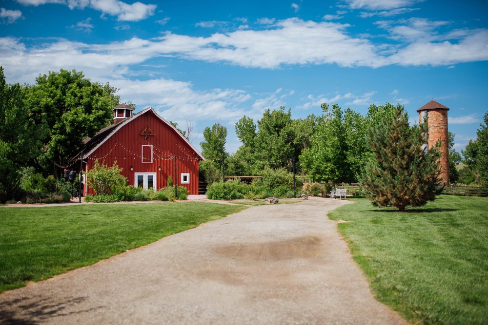 Chatfield farm at the Denver Botanic Gardens at Chatfield is one of the most beautiful wedding venues in Colorado with its signature bright red barn. Photo by Maddie Mae Photography