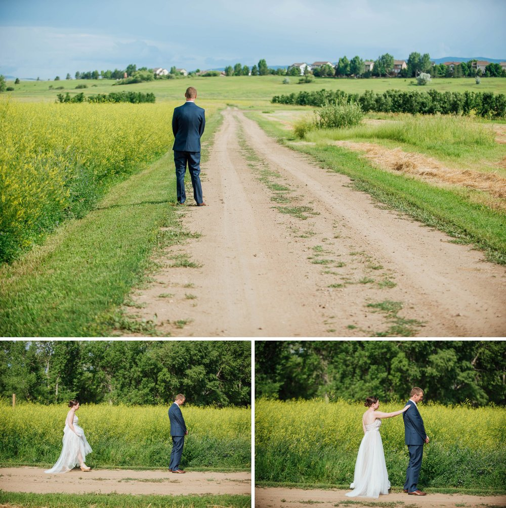 Nothing says summer wedding quite like a first look on the dirt road with meadows all around! Photo by Maddie Mae Photography