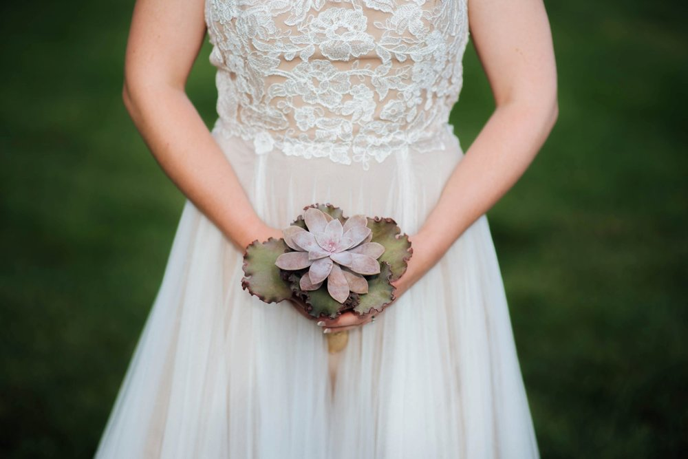 This light pink bouquet is so unique- and goes so well with her lace bodice dress. Photo by Maddie Mae Photography