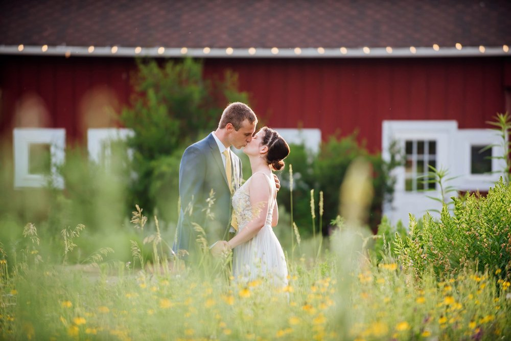 The red barn at the Chatfield farm at the Denver Botanic Garden is a great backdrop for some beautiful wedding photos. Photo by Maddie Mae Photography