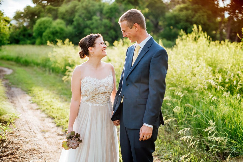 Colorado is the best place for a summer wedding. The Denver Botanic Gardens at Chatfield have so many places for interesting wedding photos. Photo by Maddie Mae Photography