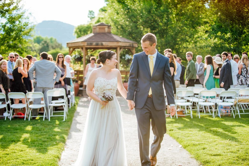 The bride and groom looks so happy as they walk back down the aisle at the Denver Botanic Gardens ceremony. Photo by Maddie Mae Photography