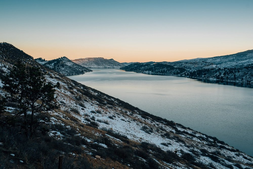 Horsetooth reservoir is the perfect venue for a Colorado winter engagement shoot. Photo by Maddie Mae Photography