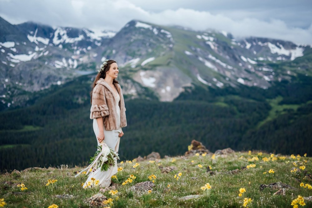 Warm coats are a must for the mountains in Rocky Mountain National Park, even in the summer! Photo by Maddie Mae Photography