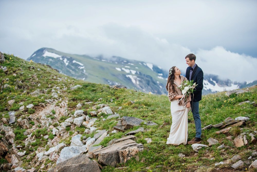 Her fur jacket is so perfect with her linen wedding dress. It can get pretty cold in the mountains even in the summer. Photo by Maddie Mae Photography