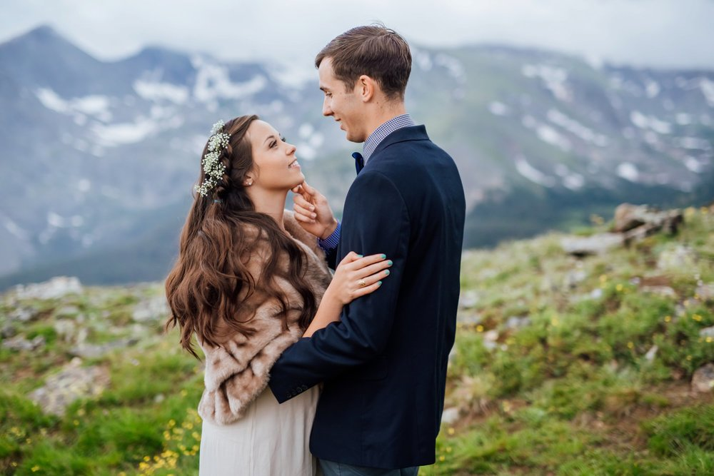 Her flower crown, fur jacket, and linen dress flow so well together for this colder mountain wedding. Photo by Maddie Mae Photography