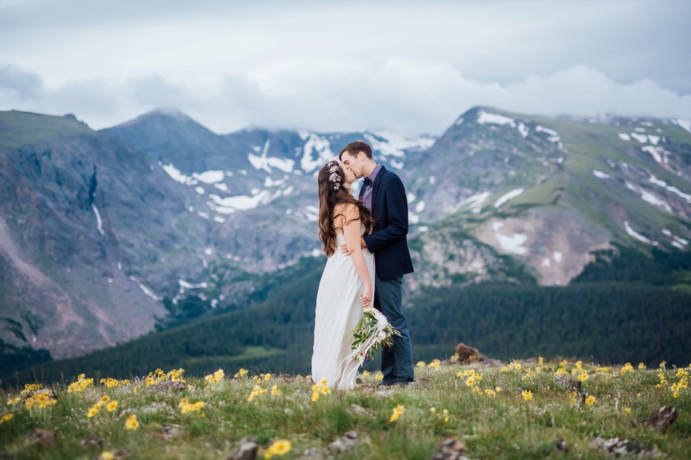 This field of flowers in the mountains is beautiful - perfect mountain wedding. Photo by Maddie Mae Photography