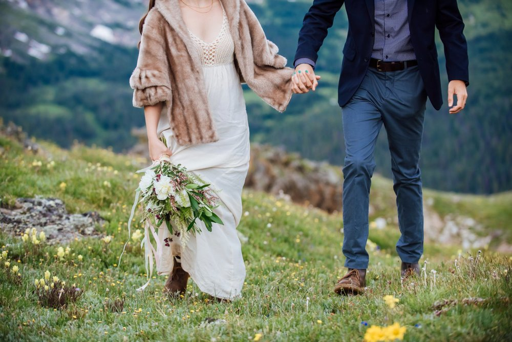 I love her fur jacket with the knitted linen dress. Her hiking boots are also perfect for this more adventurous mountain wedding. Photo by Maddie Mae Photography