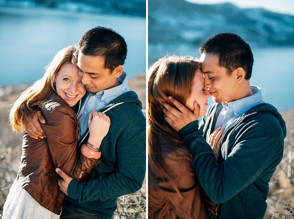 The snow covering the hills at Horsetooth reservoir is so beautiful for this Fort Collins engagement photo shoot. Photo by Maddie Mae Photography