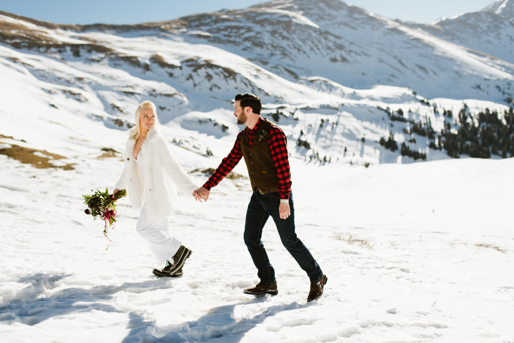What a romantic setting for a wedding! Keystone, Colorado's mountainous landscape is an amazing elopement spot! | Romantic winter wedding photo by Maddie Mae
