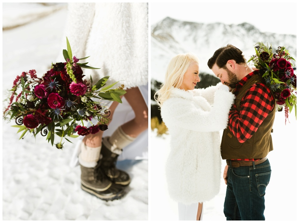 This mountainous wildflower-esque wedding bouquet really pops with the snowy winter behind it! What a gorgeous bride and groom. | Romantic wedding photography by Maddie Mae