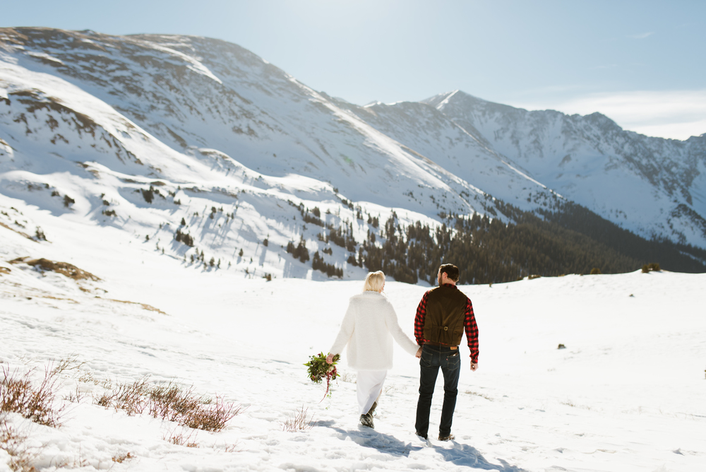 How gorgeous does this couple look out here in Keystone? I want to elope on the side of a snowcapped mountain! | Adventurous elopement photography by Maddie Mae