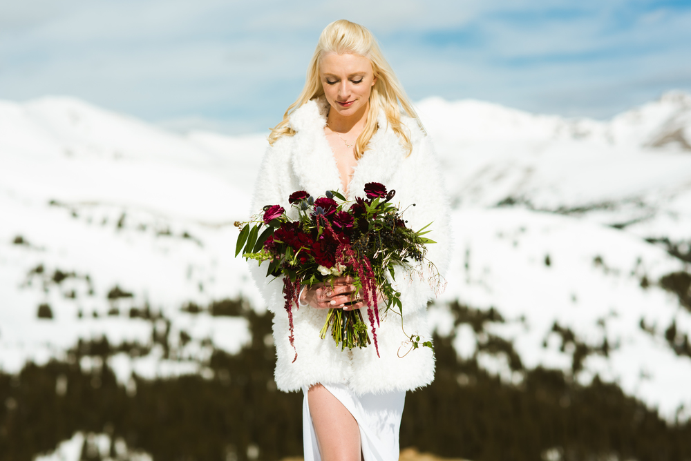 Britta is the most insanely gorgeous bride. Love the winter scape for a wedding or elopement! | Mountain wedding photography by Maddie Mae