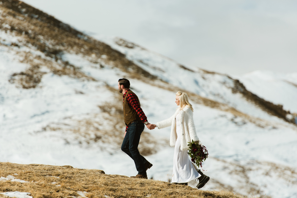 This adventurous couple hiked around A-Basin in Keystone, Colorado where they eloped surrounded by the snowcapped Rocky Mountains! | Adventurous wedding photos by Maddie Mae