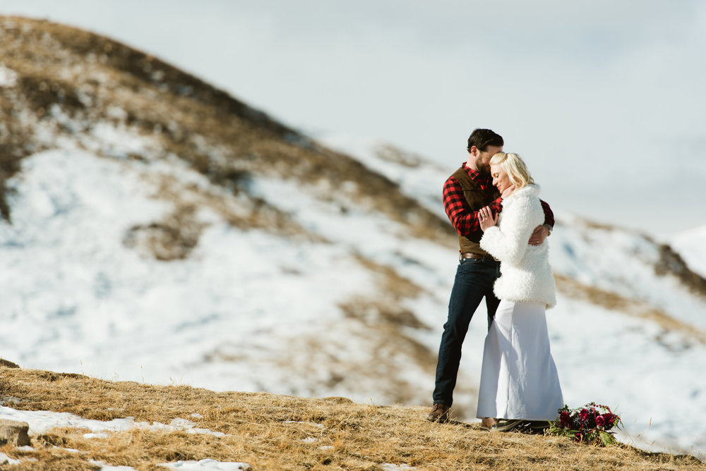 It looks chilly. but they have each other to warm up! Winter elopements are so beautiful! | Colorado elopement photography by Maddie Mae