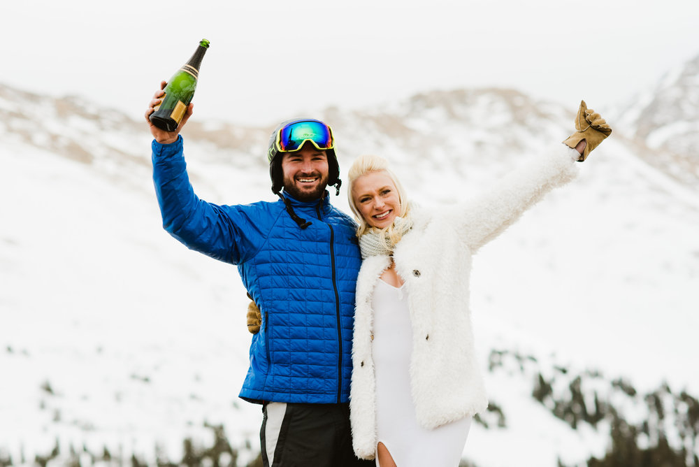 Let's celebrate!! Britta and Colin tied the knot on the snowy mountain side of A-Basin in Loveland Pass, Colorado! | Adventurous wedding photography by Maddie Mae