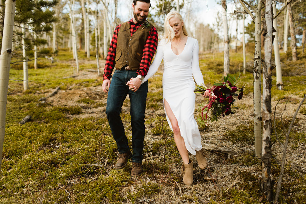 This adventurous couple eloped in a forest of Aspen trees amongst the Rocky Mountains near Black Hawk, Colorado! | Photo by adventure elopement photographer, Maddie Mae.