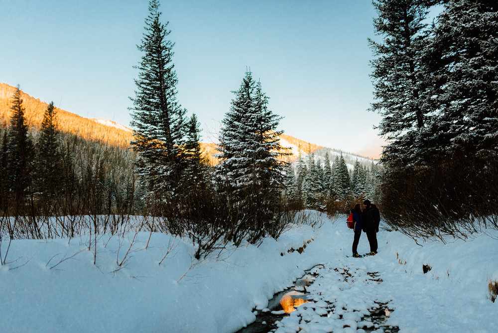 It's so romantic to see Hannah and Nick cuddled up on the Lost Lake trail in Indian Peaks Wilderness Area! I love intimate engagement sessions like this one in the Rocky Mountains! | Mountain engagement photos by adventurous wedding photographer, Maddie Mae.
