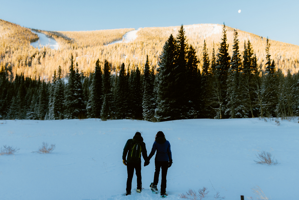 Such a special moment shared between Hannah and Nick as they celebrate their love on a mountaintop at sunrise. What an adventurous couple! I love the idea of doing a snowshoeing engagement photoshoot! | Mountain engagement photos by adventurous wedding photographer, Maddie Mae.