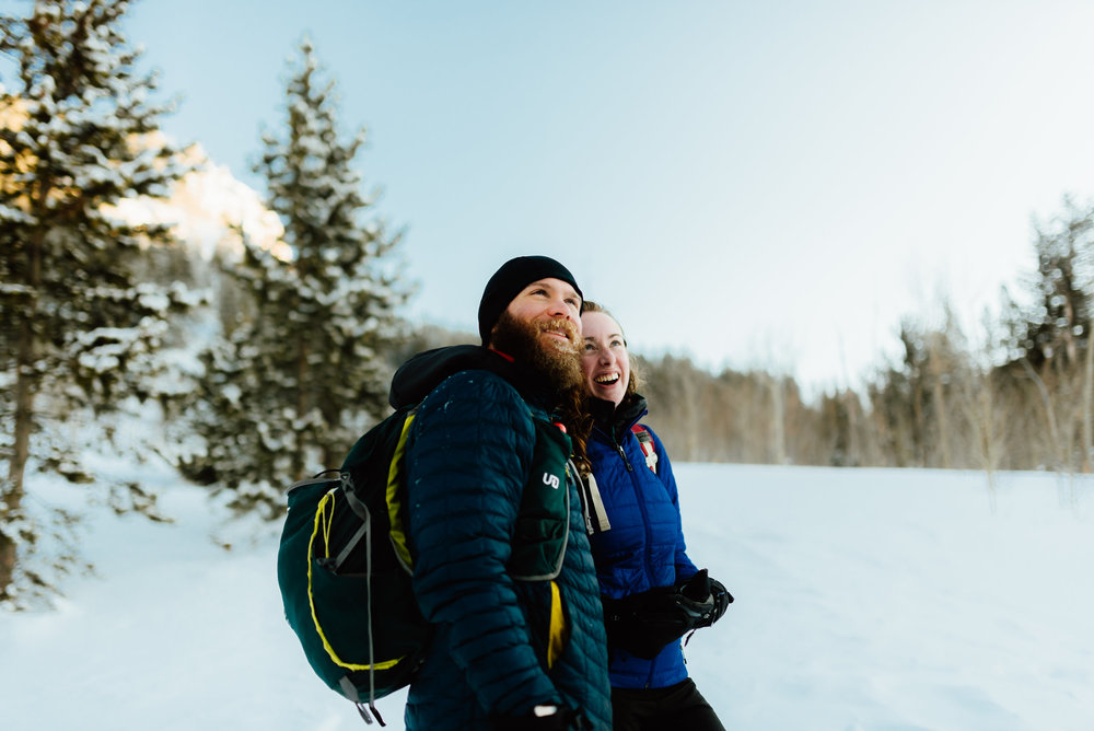 The happy couple celebrating their engagement in the Rocky Mountains! I'd love to spend a day with my fiancé hiking and snowshoeing through the forest for our engagement photos! | Colorado engagement photos by adventurous, mountain wedding photographer, Maddie Mae.