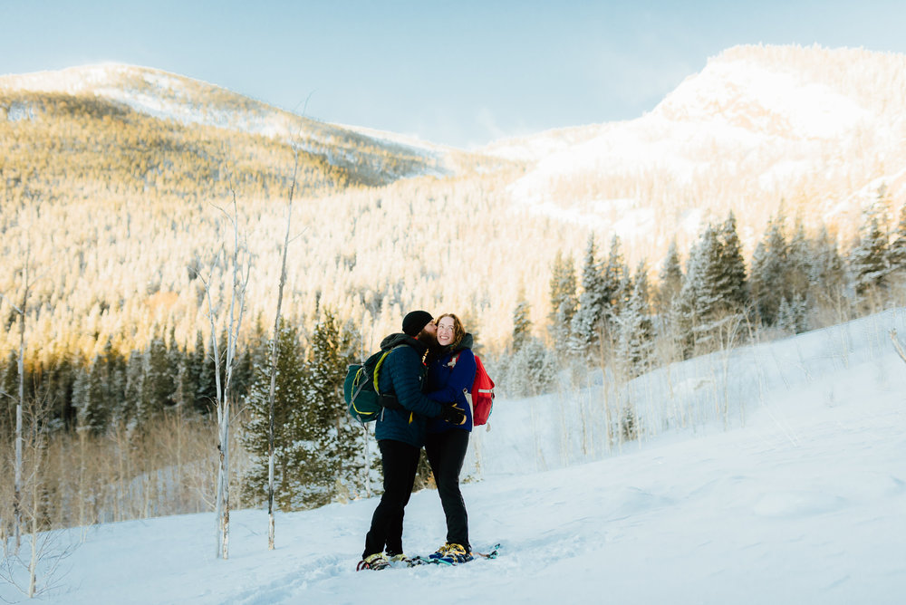 I totally want to have my engagement shoot at Lost Lake in Indian Peaks Wilderness Area! I love the idea of a mountain snowshoeing engagement photo session! | Mountain engagement photos by adventurous engagement photographer, Maddie Mae.