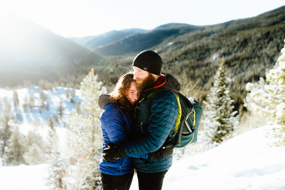 Hannah and Nick are so adorable in this morning sunlight while they snowshoe! I really love their idea to have a mountain engagement photoshoot in the Rocky Mountains! | Rocky Mountain engagement photos by Colorado engagement photographer, Maddie Mae.