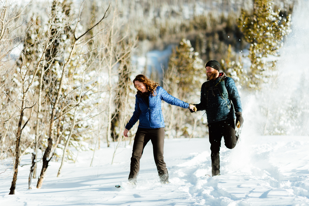 I love seeing the snow fall around Hannah and Nick at their snowshoeing hiking engagement shoot! This makes me really want to shoot my engagement photos in the winter! | Lost Lake engagement photos by intimate Colorado engagement photographer, Maddie Mae.