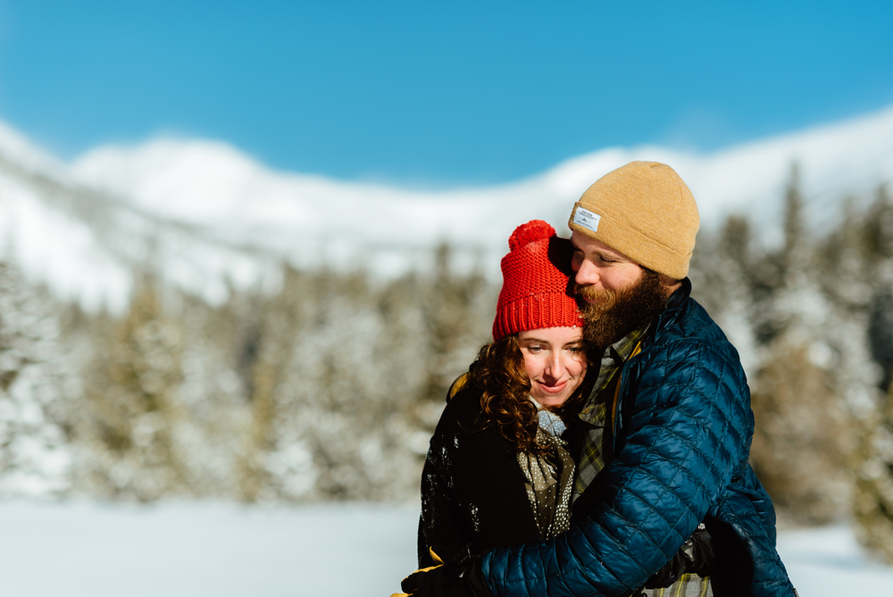 These snowy mountain engagement photos are insanely GORGEOUS! My boyfriend and I absolutely love the outdoors and I would totally want to do something adventurous for our engagement shoot like snowshoeing through Lost Lake in the winter! | Colorado engagement photos by intimate engagement photographer, Maddie Mae.