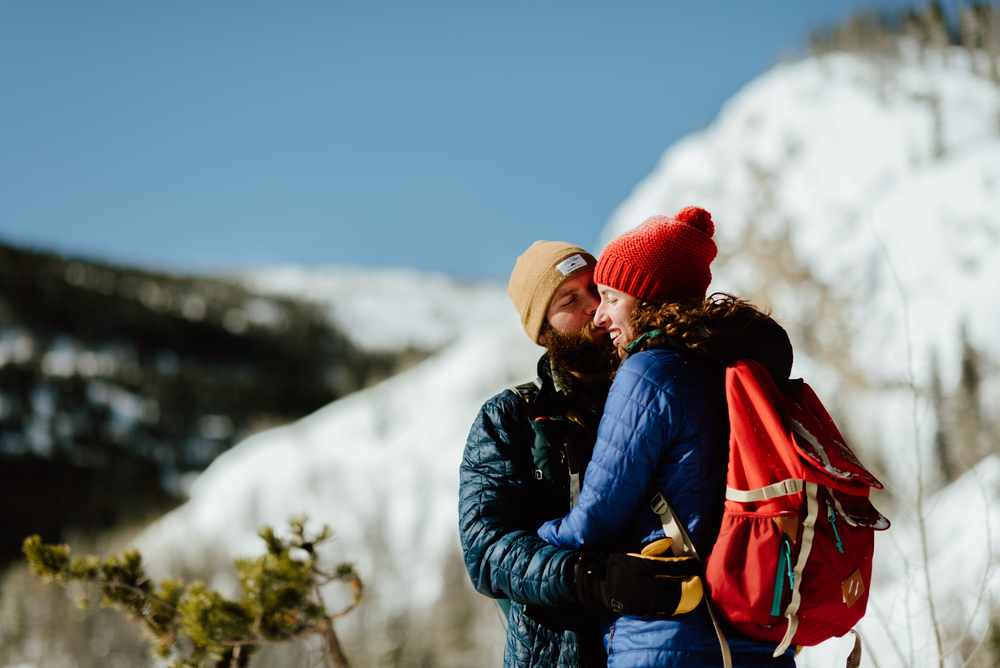 Hannah and Nick really did it right by hiking up in Indian Peaks Wilderness Area and snowshoeing for their romantic and intimate engagement photoshoot! I definitely want to throw on my hiking boots and do something similar with my fiancé! | Intimate engagement photos by Colorado engagement photographer, Maddie Mae.