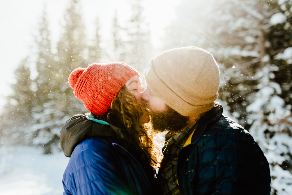 Absolutely love how romantic this sunrise mountain engagement photoshoot is. The snow falling around Hannah and Nick looks just like a fairytale! | Intimate engagement photos by Colorado engagement photographer, Maddie Mae.