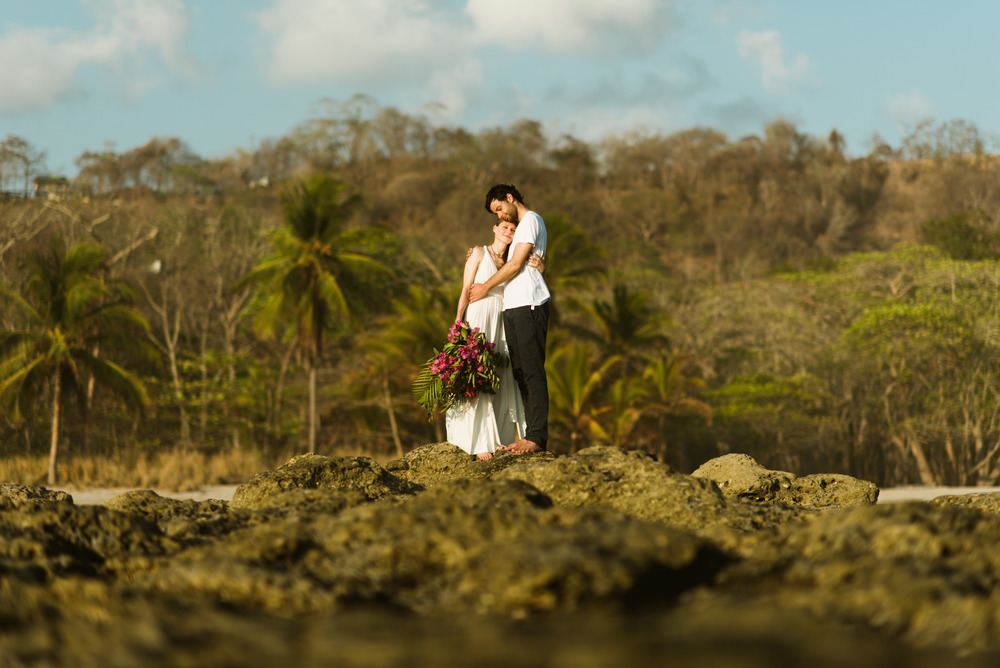 I love the moments captured of Stefan and Martina at their Costa Rica destination elopement! The lighting at sunset on Santa Teresa Beach couldn't be more stunning! | Beach wedding photography by destination wedding photographer, Maddie Mae.