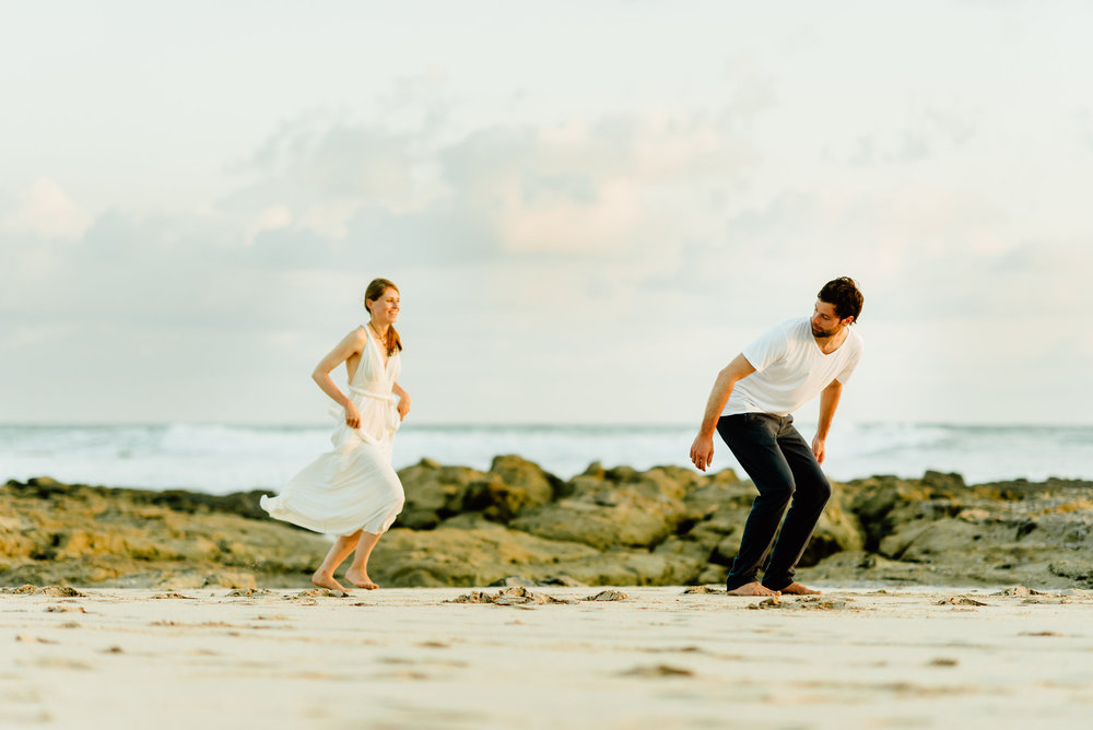 How cute is this moment... right before a piggy back ride on the romantic Nicoya Peninsula in Costa Rica!?! I can't wait for our destination beach elopement! | Destination wedding photography by Costa Rica wedding photographer, Maddie Mae.