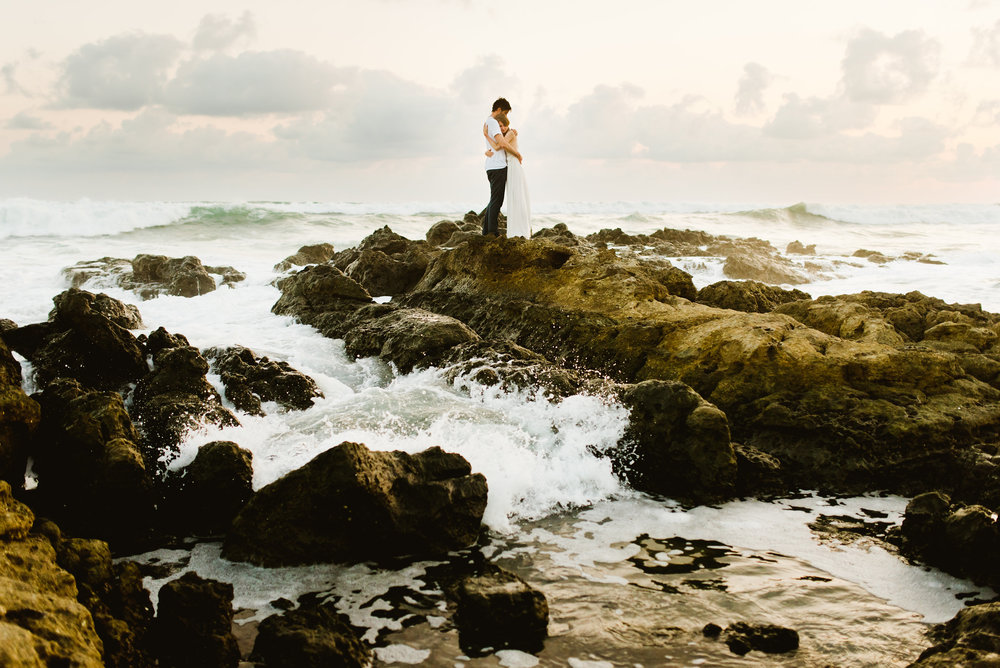 A rocky beach is so much more interesting than a sandy one for weddings and elopements... I love the way the water is splashing and spraying onto the rocks! | Costa Rica wedding photography by destination wedding photographer, Maddie Mae.