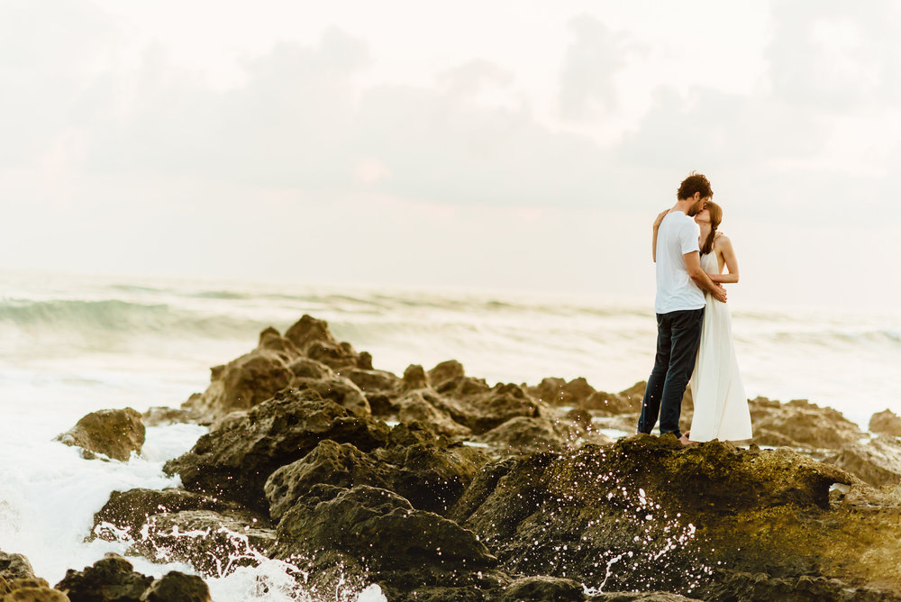 Not sure it gets any more romantic than this... newly weds celebrating their marriage on a rocky beach on the Nicoya Peninsula in Costa Rica! Santa Teresa Beach might just be the perfect destination elopement location! | Costa Rica wedding photography by destination wedding photographer, Maddie Mae.