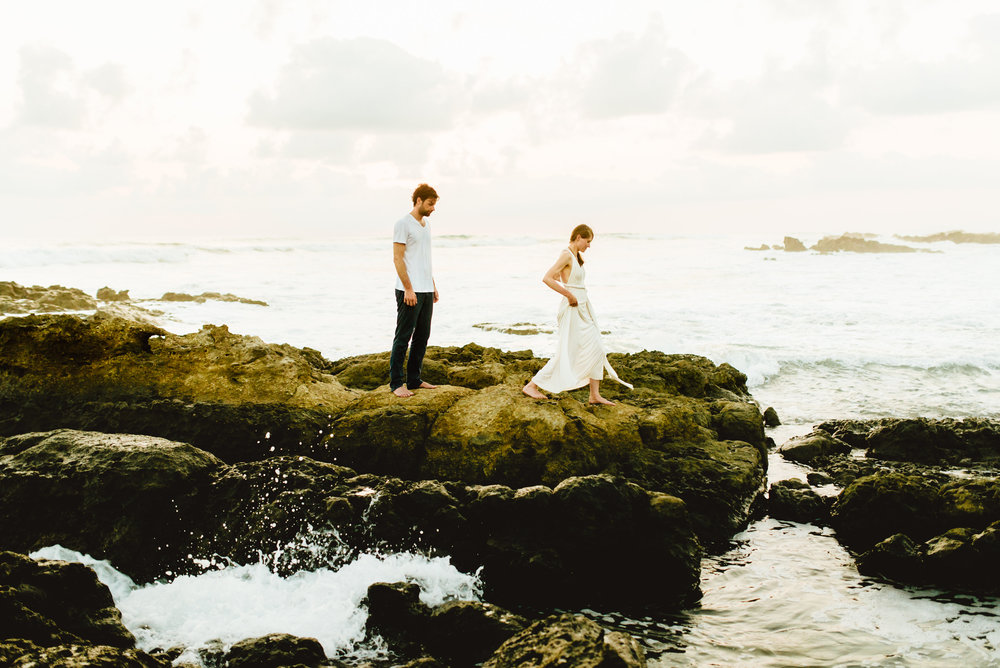 The sea spray in these amazing destination beach elopement photos is amazingly gorgeous! Santa Teresa beach is such a great wedding location! | Intimate destination wedding photography by adventure elopement photographer, Maddie Mae.
