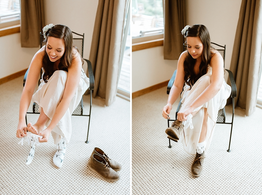 These little hiking boots are so cute for a mountain wedding! Love the idea of wearing something a little more rustic with the wedding dress! | Rocky mountain elopement photos by adventure wedding photographer, Maddie Mae.