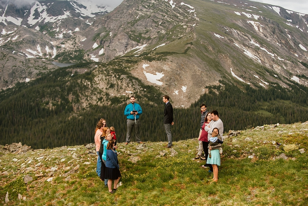 I couldn't imagine a more gorgeous mountain ceremony location than this wedding location in Estes Park, Colorado! | RMNP Trail Ridge Road wedding photos by Colorado elopement photographer, Maddie Mae.
