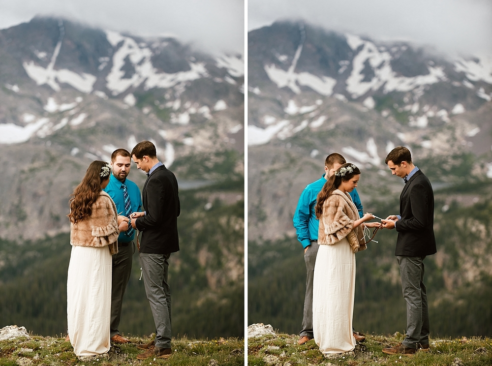 This mountain elopement has such precious moments, like this knot tying ceremony! Look at those snowy mountains in the background during their handfasting, braiding ceremony! | Rocky Mountain National Park  elopement photos by adventure wedding photographer, Maddie Mae.